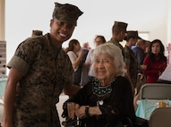 U.S. Marine Corps Corporal Mechae Reavers, a construction wireman with Headquarters Regiment, 1st Marine Logistics Group, and Clara Foussat Guy, Tribal Elder of the San Luis Rey Band of Mission Indians, pose for a picture at the Marine Corps Installations West, Marine Corps Base Camp Pendleton, Multi-Cultural Celebration, May 25, 2017. Military personnel and civilians alike spent the afternoon browsing booths of informative displays, homemade foods and crafts. (U.S Marine Corps Photo by Lance Cpl. Desiree D King)