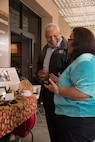 Diania Caudell discusses her Luiseno basket weaving display with Dr. Anthony Baxter, 1st Marine Division prevention analyst, at the Marine Corps Installations West, Marine Corps Base Camp Pendleton Multi-Cultural Celebration, May 25, 2017. Military personnel and civilians alike spent the afternoon browsing booths of informative displays, homemade foods and crafts. (U.S Marine Corps Photo by Lance Cpl. Desiree D King)