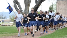 Members of the 39th Aerial Port Squadron begin their 5K Memorial Run May 7, 2017 in Capt. David Lyon Memorial Park, Peterson Air Force Base, Colo. Aerial Port Squadrons from all over the world run in May as part of National Defense Transportation events to remember their fallen brothers and sisters. Capt. David Lyon, 21st Logistics Readiness Squadron, stationed at Peterson Air Force Base, Colo., was killed in December 2013 by a vehicle-borne improvised explosive in Kabul, Afghanistan. (U.S. Air Force photo/Daniel Butterfield)