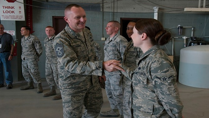 Chief Master Sgt. Jason France, Air Force Materiel Command command chief, meets with Basic Expeditionary Airfield Resources Base Airmen at Holloman Air Force Base, N.M., June 6, 2017. France traveled around BEAR Base receiving briefings from Airmen explaining how civil engineer personnel assigned to BEAR Base are unique and the importance of the various capabilities they possess. (U.S. Air Force photo/Airman 1st Class Ilyana A. Escalona)
