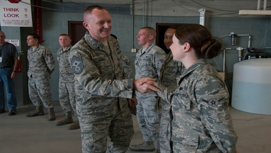 Chief Master Sgt. Jason France, Air Force Materiel Command command chief, meets with Basic Expeditionary Airfield Resources Base Airmen at Holloman Air Force Base, N.M., June 6, 2017. France traveled around BEAR Base receiving briefings from Airmen explaining how civil engineer personnel assigned to BEAR Base are unique and the importance of the various capabilities they possess. (U.S. Air Force photo by Airman 1st Class Ilyana A. Escalona)