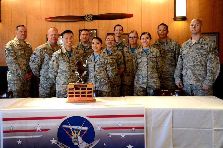 Warrior Chef teams and judges pose for a photo after the Warrior Chef competition at the Grizzly Bend, June 7, 2017 at Malmstrom Air Force Base, Mont. Four teams of two had an hour to prepare meals from scratch using fresh ingredients and incorporating mangoes as the secret ingredient.   (U.S. Air Force photo/Staff Sgt. Delia Marchick)
