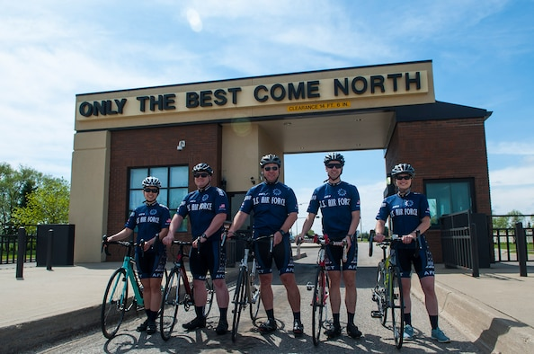Members of the Air Force Cycling Team stand in front of the gate at Minot Air Force Base, N.D., May 17, 2017. There are six Minot Air Force Base Airmen on the Air Force Cycling Team, which has more than 150 cyclists Air Force-wide. (U.S. Air Force photo/Airman 1st Class Jonathan McElderry)