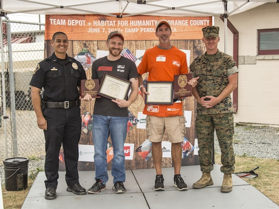 Representatives of Habitat for Humanity and Home Depot receive Certificates of Appreciation from Marine Corps Base Camp Pendleton during the K9 upgrade project aboard Camp Pendleton, Calif, June 7, 2017. Volunteers painted and repaired kennels as well as constructed a new shade structure and obstacle courses to increase the quality of training.