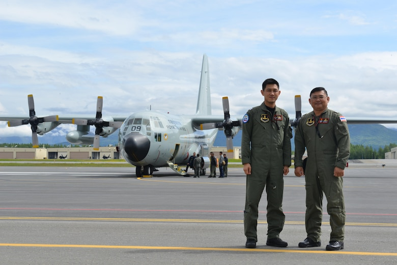 Two Royal Thai Air Force Airmen stand in front of their C-130 Hercules on the Joint Base Elmendorf-Richardson Flightline June 8 during Operation Red Flag-Alaska 17-_. RF-A is a Pacific Air Forces-directed field training exercise for U.S. and international forces flown under simulated air combat conditions. It is conducted on the Joint Pacific Alaska Range Complex with air operations flown primarily out of Eielson Air Force Base and JBER.