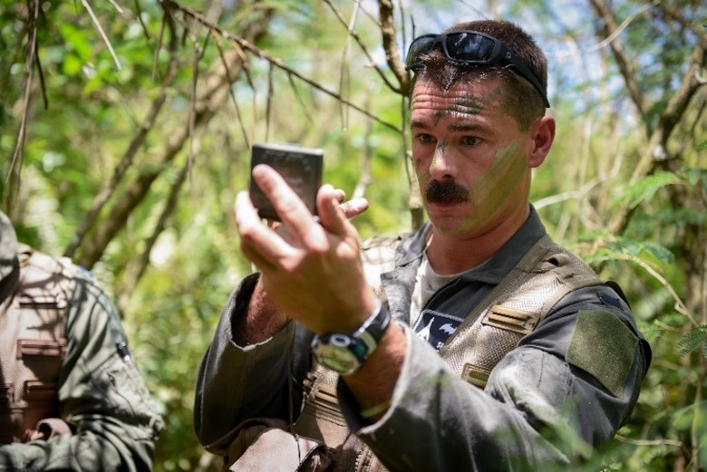 U.S. Air Force 1st Lt. Manuel Lamson, 9th Expeditionary Bomb Squadron weapon systems officer, applies camouflage face paint during a combat search and rescue training exercise June 5, 2017, at Andersen South, Guam. During the exercise, Lamson acted as a downed aircrew member, along with three other Airmen, and was tested on his ability to survive and evade in a jungle environment. (U.S. Air Force photo by Staff Sgt. Joshua Smoot)