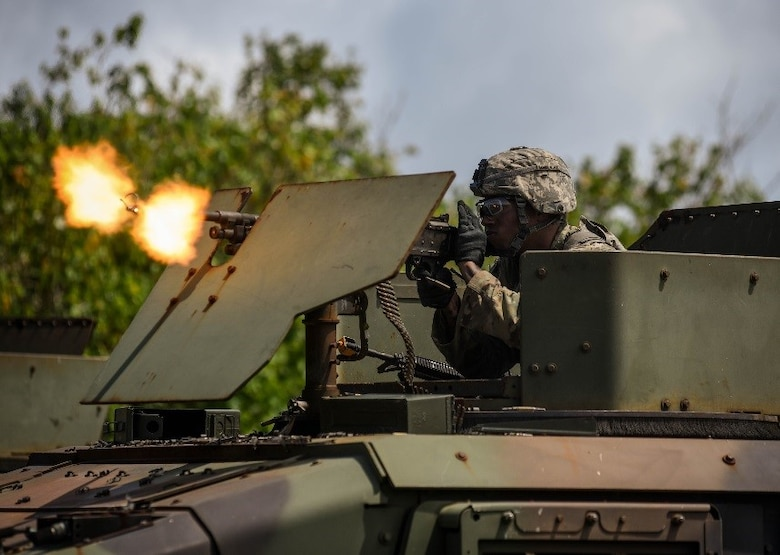 A U.S. Soldier from Task Force Talon, 94th Army Air and Missile Defense Command, fires blank rounds at opposing forces during a combat search and rescue training exercise June 5, 2017, at Andersen South, Guam. Service members from TFT, Helicopter Sea Combat Squadron Two-Five, and the 36th Wing joined together to practice survival, evasion, resistance and escape procedures, emergency evacuation techniques and quick reaction force training. This is the first time these units participated in a combat search and rescue exercise together on Guam. (U.S. Air Force photo by Staff Sgt. Joshua Smoot)