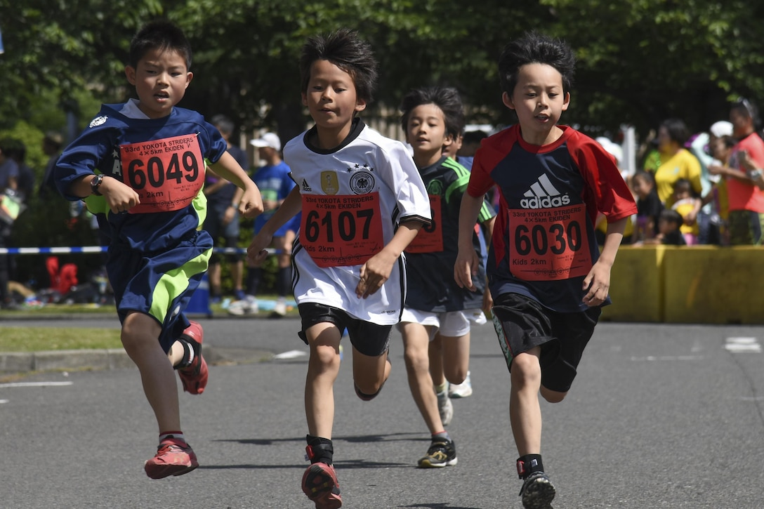 Children run the home stretch of the 2K Kids Run during the 33rd Annual Yokota Striders Ekiden at Yokota Air Base, Japan, June 4, 2017. The races, which consisted of a 2K Kids Run, 2K Family Run, 5K Race and the main Ekiden Race event, promoted friendship and physical fitness. (U.S. Air Force photo by Machiko Arita)