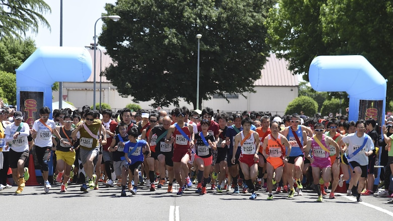 Competitors start running the main event, the Ekiden at Yokota Air Base, Japan, June 4, 2017. An Ekiden is a Japanese long distance relay that consists of teams of runners covering a certain distance. The Yokota Ekiden is 20K in distance made up of four runners each running a 5K. (U.S. Air Force photo by Machiko Arita)