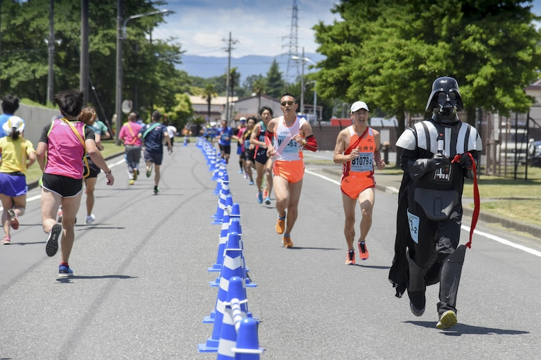 A participant runs in costume during the 33rd Annual Yokota Striders Ekiden at Yokota Air Base, Japan, June 4, 2017. An Ekiden is a Japanese long distance relay that consists of teams of runners covering a certain distance. The Yokota Ekiden is 20K in distance made up of four runners each running a 5K. (U.S. Air Force photo by Machiko Arita)