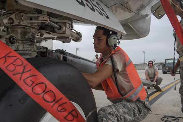 U.S. Air Force Airman Angel Manriquez,961st Aircraft Maintenance Unit crew chief apprentice, connects a tow bar to an E-3 Sentry from the 961st Airborne Air Control Squadron June 8, 2017, at Kadena Air Base, Japan. The AMU is comprised of crew chiefs and specialists who band together to ensure the E-3 Sentry AWACS maintains its operational capability. (U.S. Air Force photo by Senior Airman John Linzmeier)