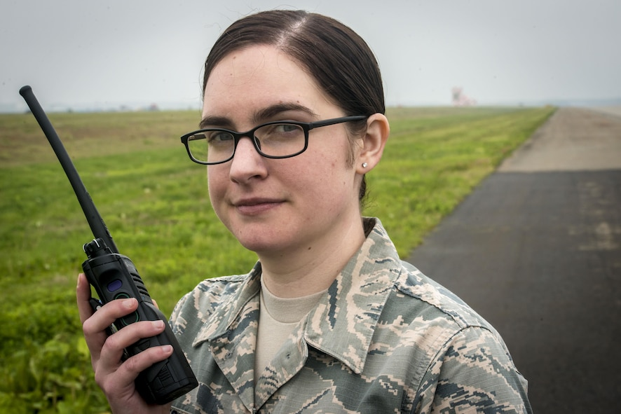 "U.S. Air Force Airman 1st Class Kelly Coats, a 35th Operations Support Squadron airfield manager, poses for a photo on the flight line at Misawa Air Base, Japan, May 25, 2017. In her capacity, Coats cares for the maintenance of runways, lighting and other airfield components and systems, and helps ensure all takeoffs and landings can proceed without incident. When she's not working, she's drawing the base's comic strip, ""Airmanitis."" Coats' art is her escape from reality lending to her resiliency as a warfighter in the Pacific theater. (U.S. Air Force photo by Tech. Sgt. Benjamin W. Stratton)"
