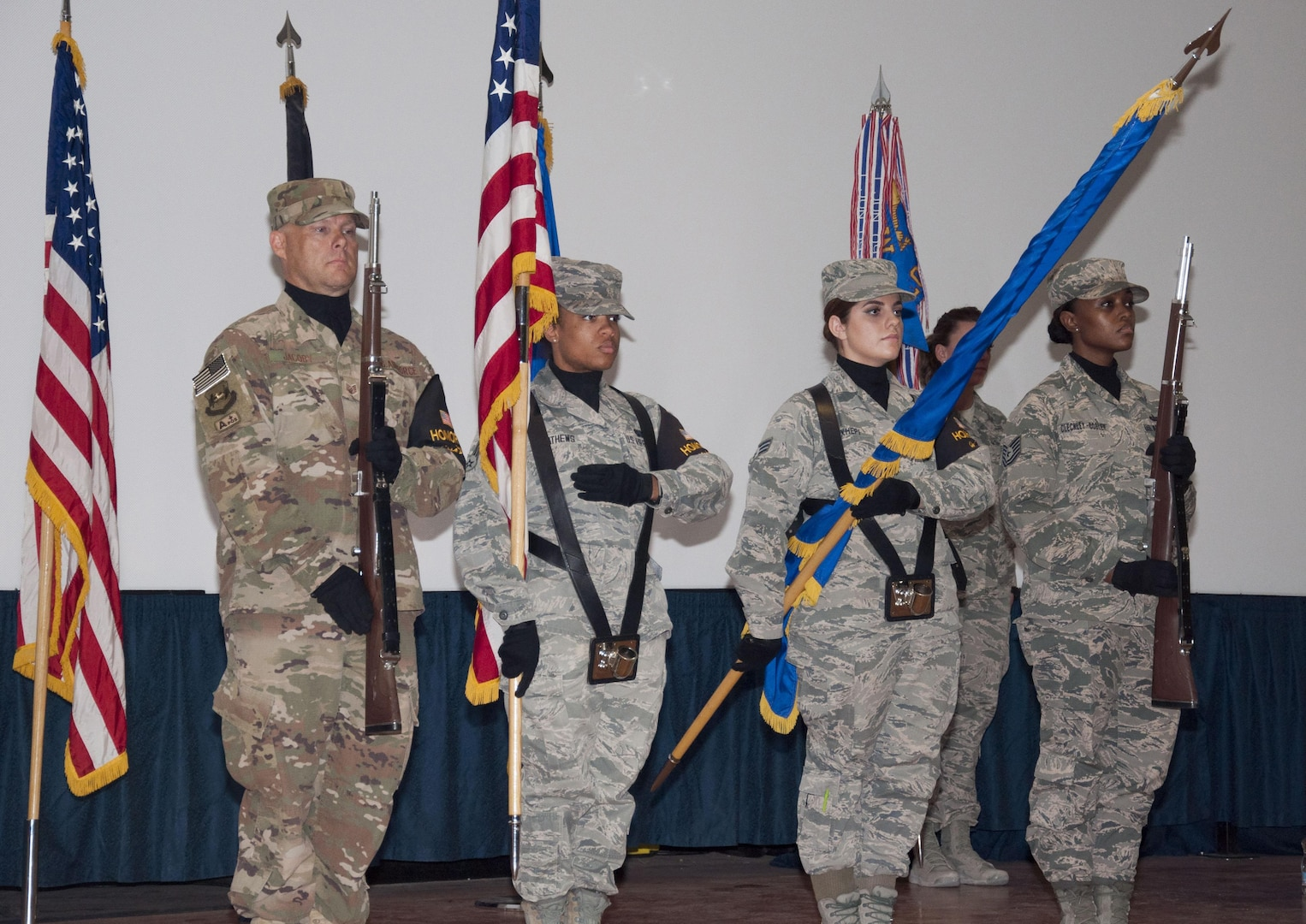 The 386 Air Expeditionary Wing honor guard presents the colors at a change-of-command ceremony Monday, June 5, 2017, at the base theater at an undisclosed location in Southwest Asia.. The honor guard performs at about a fifty events per six-month rotation.