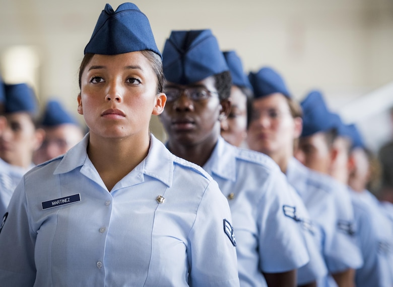 Airman 1st Class Sonya Martinez, with the 96th Medical Group, stands in formation during the 96th Test Wing change of command ceremony at Eglin Air Force Base, Fla., May 31, 2017.  Brig. Gen. Christopher Azzano relinquished command to Brig. Gen. Evan Dertien. The command position is Dertien's third assignment to Team Eglin.  (U.S. Air Force photo/Samuel King Jr.)