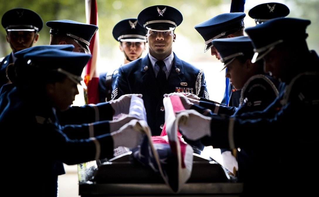 Staff Sgt. Gregory Barker, with the 96th Force Support Squadron, presides over the flag-folding portion of the Honor Guard graduation ceremony at Eglin Air Force Base, Fla., June 1, 2017. Approximately 12 new Airmen graduated from the course after more than 120 hours of training. The graduation performance, for friends, family and unit commanders, includes flag detail, rifle volley, pallbearers and bugler. (U.S. Air Force photo/Samuel King Jr.)