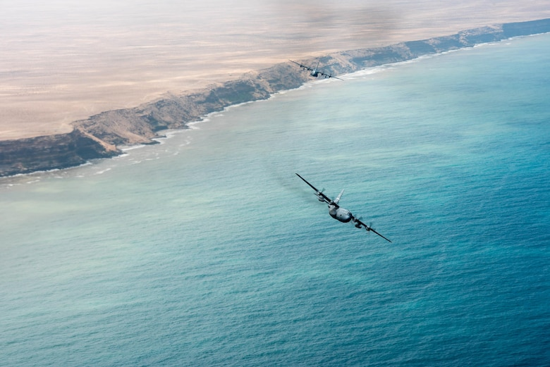 Two Kentucky Air National Guard C-130 Hercules fly over the coast of North Africa on April 25, 2017. Various units from the U.S. Marine Corps, U.S. Army, U.S. Navy, U.S. Air Force and the Kentucky and Utah Air National Guards will conduct multilateral and stability operations training with units from the Royal Moroccan Armed Forces in the Kingdom of Morocco. This combined multilateral exercise is designed to improve interoperability and mutual understanding of each nation's tactics, techniques and procedures while demonstrating the strong bond between the nation's militaries. (U.S. Air Force photo by Master Sgt. Phil Speck)