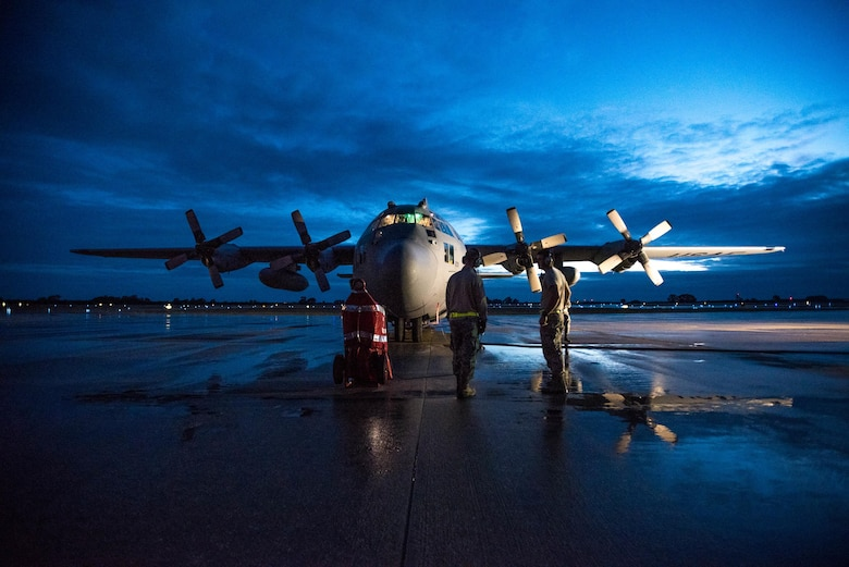 Kentucky Air National Guard crew chiefs prepare a 123rd Airlift Wing C-130 Hercules for flight at Naval Station Rota, Spain, prior to take off on April 27, 2017, during Exercise African Lion. Multiple units from the U.S. Marine Corps, U.S. Army, U.S. Navy, U.S. Air Force and the Kentucky and Utah Air National Guards conducted multilateral and stability operations training with units from the Royal Moroccan Armed Forces in the Kingdom of Morocco during the exercise, which ran from April 19 to 28. The annual combined multilateral exercise is designed to improve interoperability and mutual understanding of each nation's tactics, techniques and procedures while demonstrating the strong bond between the nations' militaries. (U.S. Air Force photo by Master Sgt. Phil Speck)