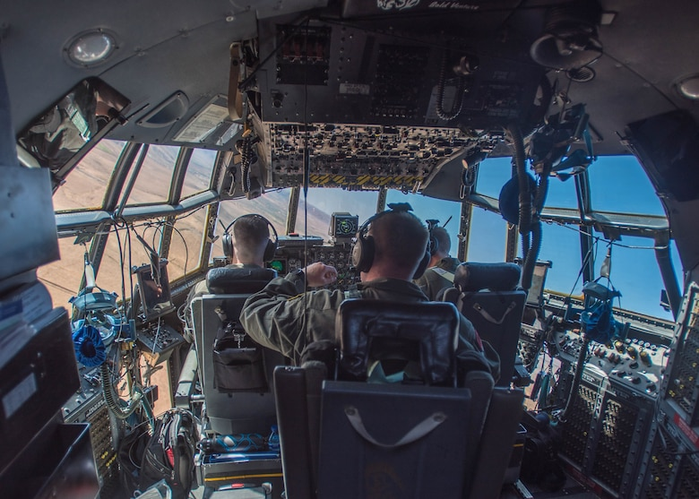 Aircrew members from the Kentucky Air National Guard's 165th Airlift Squadron turn to final approach before landing a 123rd Airlift Wing C-130 Hercules into Guelmim, Morocco, on April 27, 2017, during Exercise African Lion. Multiple units from the U.S. Marine Corps, U.S. Army, U.S. Navy, U.S. Air Force and the Kentucky and Utah Air National Guards conducted multilateral and stability operations training with units from the Royal Moroccan Armed Forces in the Kingdom of Morocco during the exercise, which ran from April 19 to 28. The annual combined multilateral exercise is designed to improve interoperability and mutual understanding of each nation's tactics, techniques and procedures while demonstrating the strong bond between the nations' militaries. (U.S. Air Force photo by Master Sgt. Phil Speck)