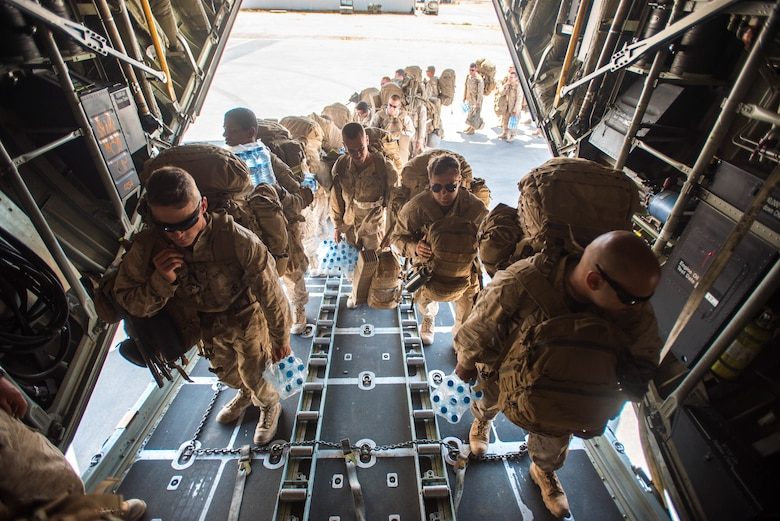 U.S. Marines board a Kentucky Air National Guard C-130 Hercules at Guelmim Airport in Morocco on April 27, 2017, during Exercise African Lion. Multiple units from the U.S. Marine Corps, U.S. Army, U.S. Navy, U.S. Air Force and the Kentucky and Utah Air National Guards conducted multilateral and stability operations training with units from the Royal Moroccan Armed Forces in the Kingdom of Morocco during the exercise, which ran from April 19 to 28. The annual combined multilateral exercise is designed to improve interoperability and mutual understanding of each nation's tactics, techniques and procedures while demonstrating the strong bond between the nations' militaries. (U.S. Air Force photo by Master Sgt. Phil Speck)