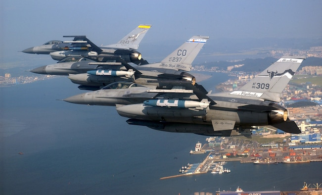 A three-ship formation of Air National Guard F-16 Fighting Falcons flies over Kunsan City, South Korea. The F-16s are from New Mexico, Colorado and Montana. (U.S. Air Force photo/Tech. Sgt. Jeffrey Allen)