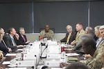 Army Brig. Gen. Sylvester Cannon, 135th Sustainment Command (Expeditionary), is briefed on DLA Distribution's global distribution network and support to Foreign Military Sales.