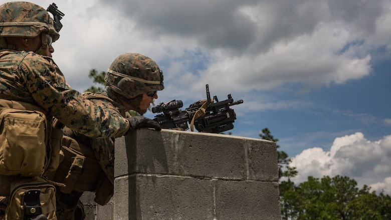 A Marine steadies an M320 grenade launcher module mounted on an M4 rifle on a wall before engaging simulated enemies at Camp Lejeune, N.C., June 6, 2017. 2nd Combat Engineer Battalion is one of the first Marine Corps units to test the M320, a more effective weapon system than the current M203 grenade launcher.