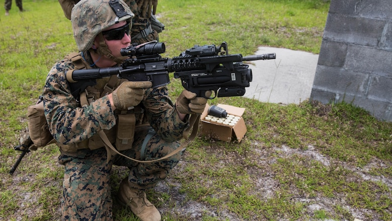 A Marine prepares to fire an M320 grenade launcher module mounted on an M4 rifle at simulated enemy targets at Camp Lejeune, N.C., June 6, 2017. 2nd Combat Engineer Battalion is one of the first Marine Corps units to test the M320, a more effective weapon system than the current M203 grenade launcher.