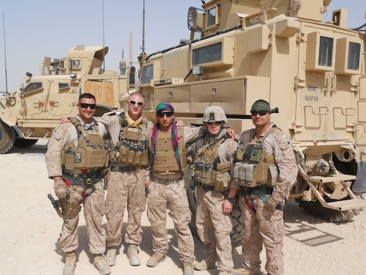 Mohammad Nadir (center) poses with a group of Marines during a base construction project for the Afghan police in Helmand province, Afghanistan. Nadir served as an interpreter for the International Security Assistance Force for nearly three years before applying for a Special Immigrant Visa that would allow him to immigrate to the U.S. After working closely with the Marines, Nadir decided he wanted to follow suit and enlisted in the Marine Corps in February 2017 as an 0311 infantryman.