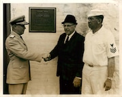 Light Station Boston, Massachusetts Left to right: Rear Admiral James A. Alger, Jr., Commander, First Coast Guard District, Osborne Earle Hallett, Keeper of Nobska Point Lighthouse, Woods Hole, Mass., and former Keeper of Boston Light, Boatswain's Mate First Class Mike Mikelonis, Officer in Charge of Boston Light.