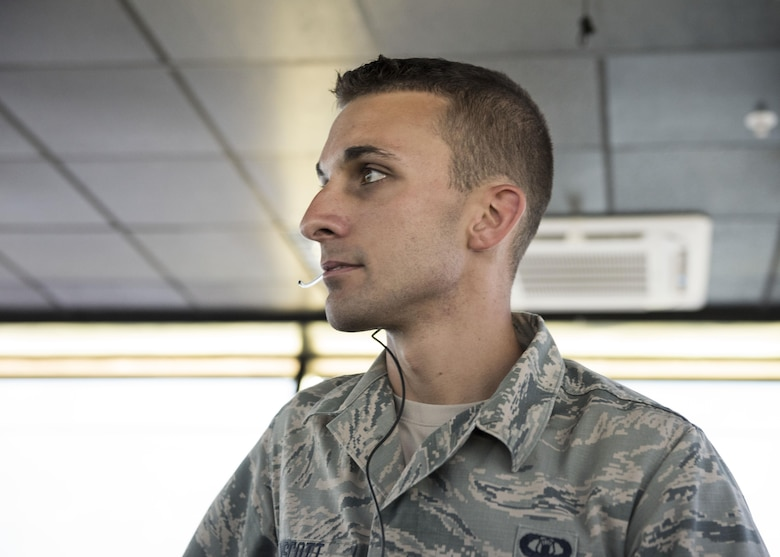 Senior Airman Jacob Winscott, 39th Operations Support Squadron air traffic controller, scans the horizon for incoming aircraft June 6, 2017, at Incirlik Air Base, Turkey. The 39th OSS airfield operations flight was recently awarded the U.S. Air Forces in Europe Airfield Complex of the Year award for 2016. (U.S. Air Force photo by Airman 1st Class Kristan Campbell)