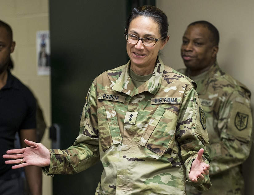 Maj. Gen. Marion Garcia, commanding general of the 200th Military Police Command, thanks her staff for surprising her with a small celebration at Fort Meade, Maryland, to congratulate her on her recent promotion, June 8. (U.S. Army Reserve photo by Master Sgt. Michel Sauret)