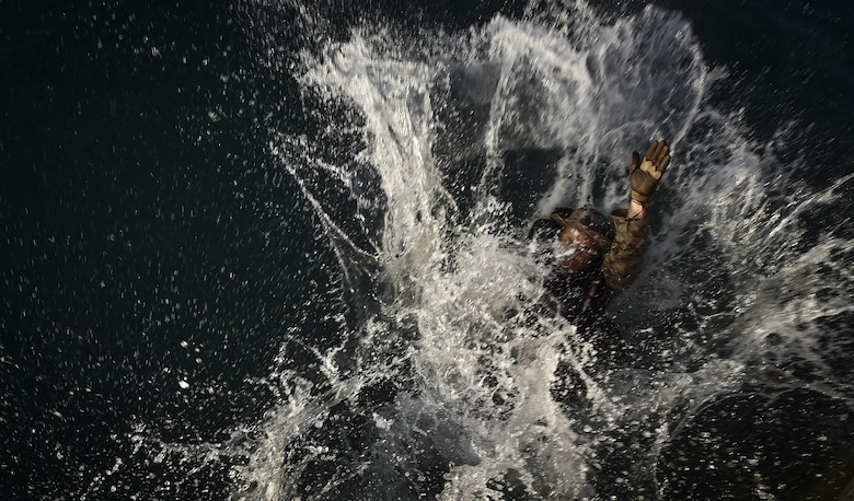 A U.S. Marine practices helocasting off a sea wall during Marine Special Operations School's Individual Training Course, March 21, 2017, at Key West, Fla. For the first time, U.S. Air Force Special Tactics Airmen spent three months in Marine Special Operations Command's Marine Raider training pipeline, representing efforts to build joint mindsets across special operations forces.  (U.S. Air Force photo by Senior Airman Ryan Conroy)