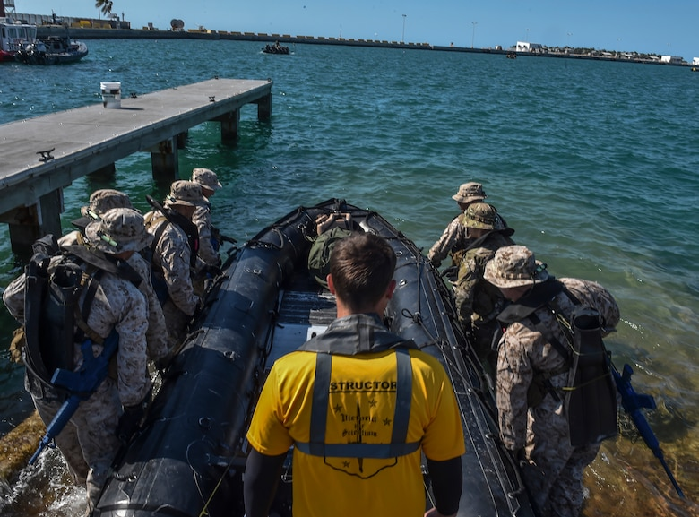 U.S. Marines and Airmen carry a Zodiac boat to the water during Marine Special Operations School's Individual Training Course, March 22, 2017, at Key West, Fla. For the first time, U.S. Air Force Special Tactics Airmen spent three months in Marine Special Operations Command's Marine Raider training pipeline, representing efforts to build joint mindsets across special operations forces.  (U.S. Air Force photo by Senior Airman Ryan Conroy)
