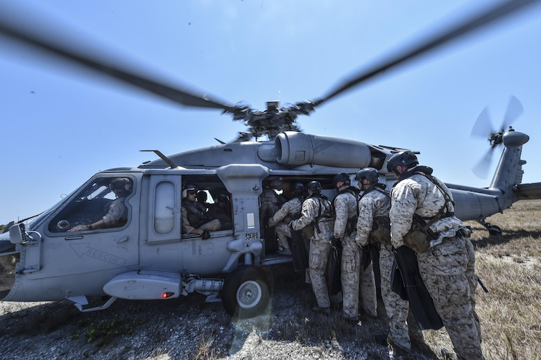 Marine Special Operations School Individual Training Course students load onto a U.S. Navy SH-60 Seahawk Helicopter for helocasting training, March 23, 2017, at Key West, Fla. For the first time, U.S. Air Force Special Tactics Airmen spent three months in Marine Special Operations Command's Marine Raider training pipeline, representing efforts to build joint mindsets across special operations forces.  (U.S. Air Force photo by Senior Airman Ryan Conroy)