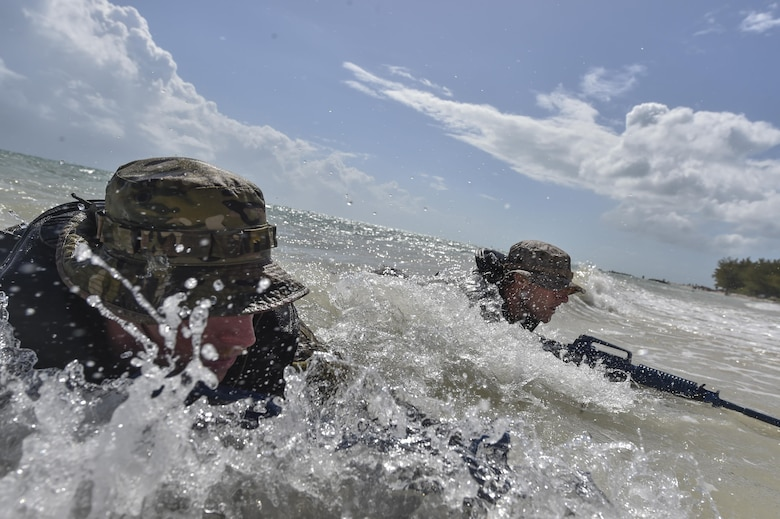 A U.S. Marine and Airman perform scout swimmer training during Marine Special Operations School's Individual Training Course, March 24, 2017, at Key West, Fla. For the first time, U.S. Air Force Special Tactics Airmen spent three months in Marine Special Operations Command's Marine Raider training pipeline, representing efforts to build joint mindsets across special operations forces.  (U.S. Air Force photo by Senior Airman Ryan Conroy)