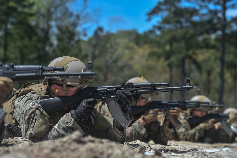 U.S. Marines and Airmen fire Kalashnikov AK-47 assault rifles during a foreign-weapons familiarization class at Marine Special Operations School's Individual Training Course, April 10, 2017, at Camp Lejeune, N.C. For the first time, U.S. Air Force Special Tactics Airmen spent three months in Marine Special Operations Command's Marine Raider training pipeline, representing efforts to build joint mindsets across special operations forces.  (U.S. Air Force photo by Senior Airman Ryan Conroy)