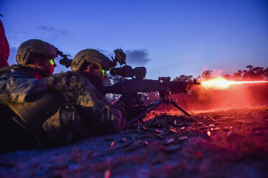 Marine Special Operations School Individual Training Course students fire an M249 squad automatic weapon during night-fire training April 13, 2017, at Camp Lejeune. For the first time, U.S. Air Force Special Tactics Airmen spent three months in Marine Special Operations Command's Marine Raider training pipeline, representing efforts to build joint mindsets across special operations forces.  (U.S. Air Force photo by Senior Airman Ryan Conroy)