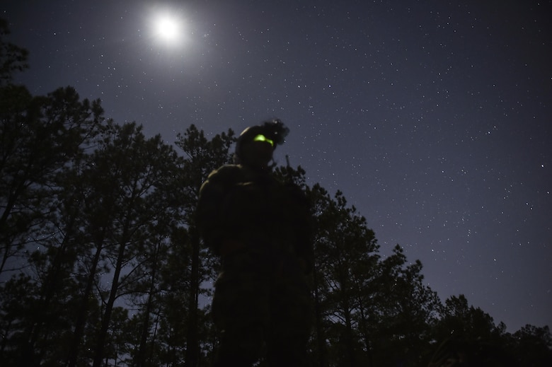 A Marine Special Operations School student maintains security during Field Training Exercise Raider Spirit, May 2, 2017, at Camp Lejeune, N.C. For the first time, U.S. Air Force Special Tactics Airmen spent three months in Marine Special Operations Command's Marine Raider training pipeline, representing efforts to build joint mindsets across special operations forces.  (U.S. Air Force photo by Senior Airman Ryan Conroy)