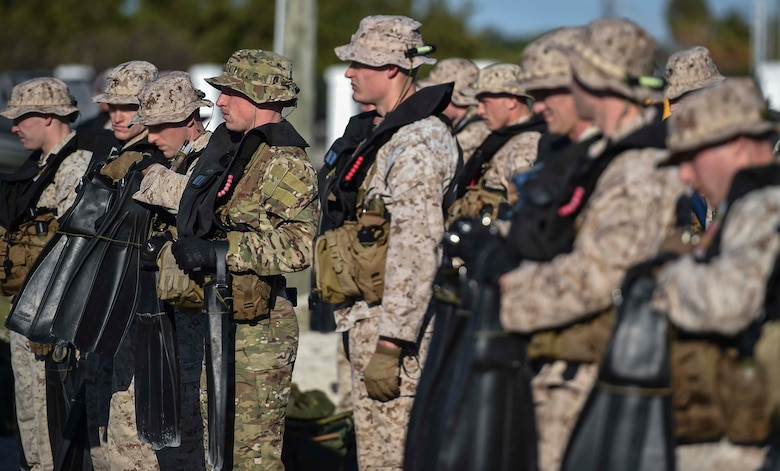 U.S. Marines and Airmen line up for a fin inspection during the Marine Special Operations School's Individual Training Course, March 20, 2017 at Key West, Fla. For the first time, U.S. Air Force Special Tactics Airmen spent three months in Marine Special Operations Command's Marine Raider training pipeline, representing efforts to build joint mindsets across special operations forces. (U.S. Air Force photo by Senior Airman Ryan Conroy)