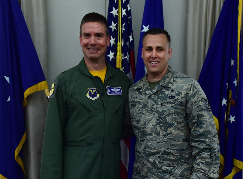 "U.S. Air Force Brig. Gen. Paul W. Tibbets IV, left, the 509th Bomb Wing commander, stands with Tech. Sgt. Joshua White, the NCO in charge of force health management, at Whiteman Air Force Base, Mo., May 19, 2017. White submitted ""Trinity Tavern"" when a survey was sent out proposing various new names for the lounge area in the western wing of Mission's End. (U.S. Air Force photo by Airman Michaela R. Slanchik)"