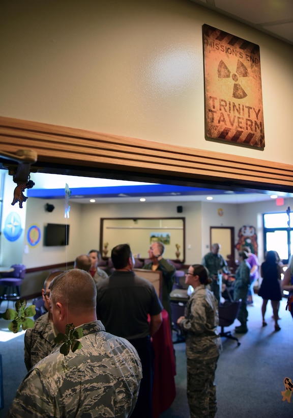 Members of Team Whiteman gather in the Mission's End Trinity Tavern after its renaming ceremony at Whiteman Air Force Base, Mo., June 2, 2017. The new name, submitted by U.S. Air Force Tech. Sgt. Joshua White, the 509th Medical Operations Squadron NCO in charge of force health management, was selected for its tie to the nuclear history of the Trinity Test site, amongst other notable U.S. military history connections.  (U.S. Air Force photo by Airman 1st Class Jazmin Smith)
