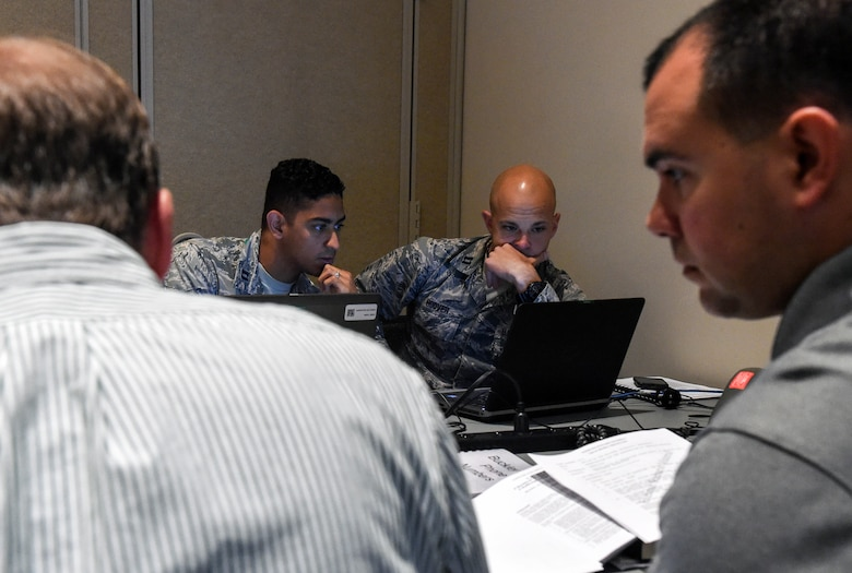 Capt. John Red (left), 460th Space Wing Plans and Programs technical advisor, and Capt. Jonathon Hoover, 460th SW Judge Advocate General, review a plan during the Chemical Weapons Convention Treaty training exercise June 6-8, 2017, at Buckley Air Force Base, Colo. The team provided base support in order to complete the exercise in the most realistic way possible. (U.S. Air Force photo by Tech. Sgt. Nicholas Rau)
