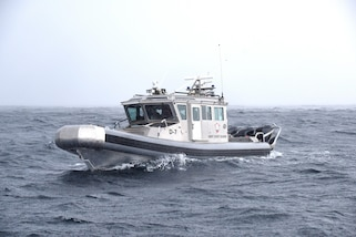 A 33-foot boat from the Antigua and Barbuda Coast Guard is shown in the water near Bridgetown, Barbados, June 8, 2017.  The Antigua and Barbuda Coast Guard is participating in Tradewinds 2017, a joint, combined exercise conducted in conjunction with partner nations to enhance the collective abilities of defense forces and constabularies to counter transnational organized crime, and to conduct humanitarian/disaster relief operations. (U.S. Coast Guard by Petty Officer 1st Class Melissa Leake/Released)