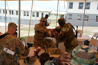 Sgt. 1st Class Samuel Amador, an Infantryman with the 1/124th Infantry Regiment, 83rd Infantry Combat Brigade Team, Florida Army National Guard, distributes training ammunition to a member of the Barbados Defence Force who is participating in Tradewinds 2017 at Paragon Base, Barbados, June 8, 2017. Tradewinds is a joint, combined exercise conducted in conjunction with partner nations to enhance the collective abilities of defense forces and constabularies to counter transnational organized crime, and to conduct humanitarian/disaster relief operations.