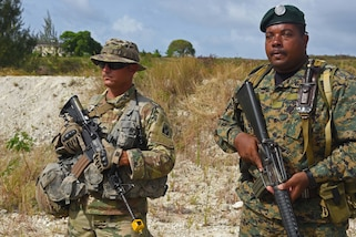 Florida National Guard Sgt. Randall Green stands guard with a member of the Barbados Defence Force during defensive position training during Tradewinds 2017 in Barbados, June 8. Military and civilians from over 20 countries are participating in this year's exercise in Barbados and Trinidad & Tobago, which runs from June 6-17, 2017. (US Army National Guard Photo by Sgt. Garrett L. Dipuma)
