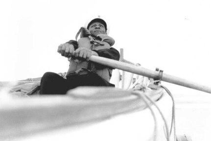 Station Pea Island, North Carolina USLSS Station #17, Sixth District  Coast Guard Station #177 Surfman Lonnie C. Gray, USCG    Surfman Lonnie C. Gray of the Pea Island Station pulls at an oar in the station's surfboat. No photo number/date; probably 1942.