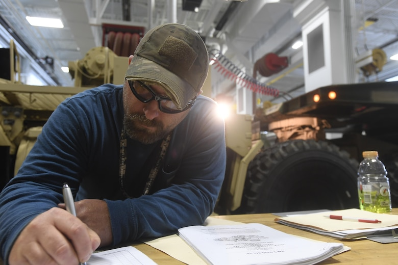 Eric Lambert, an automotive mechanic with the Army Support Activity Logistics Readiness Center, conducts an inspection of a vehicle in an engineering bay at Joint Base McGuire-Dix-Lakehurst, New Jersey, June 7, 2017. The LRC's mechanics and machinists are qualified to maintain and repair over 60 different vehicles ranging from light equipment to heavy equipment.
