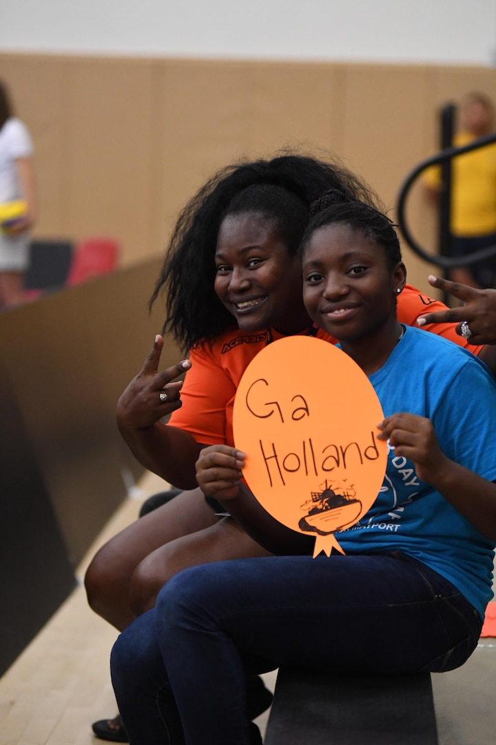 Fans cheering on the Netherlands in Match 5 of the 18th Conseil International du Sport Militaire (CISM) World Women's Military Volleyball Championship on 6 June 2017 at Naval Station Mayport, Florida. (Photo by Petty Officer 2nd Class Timothy Schumaker, NPASE East).