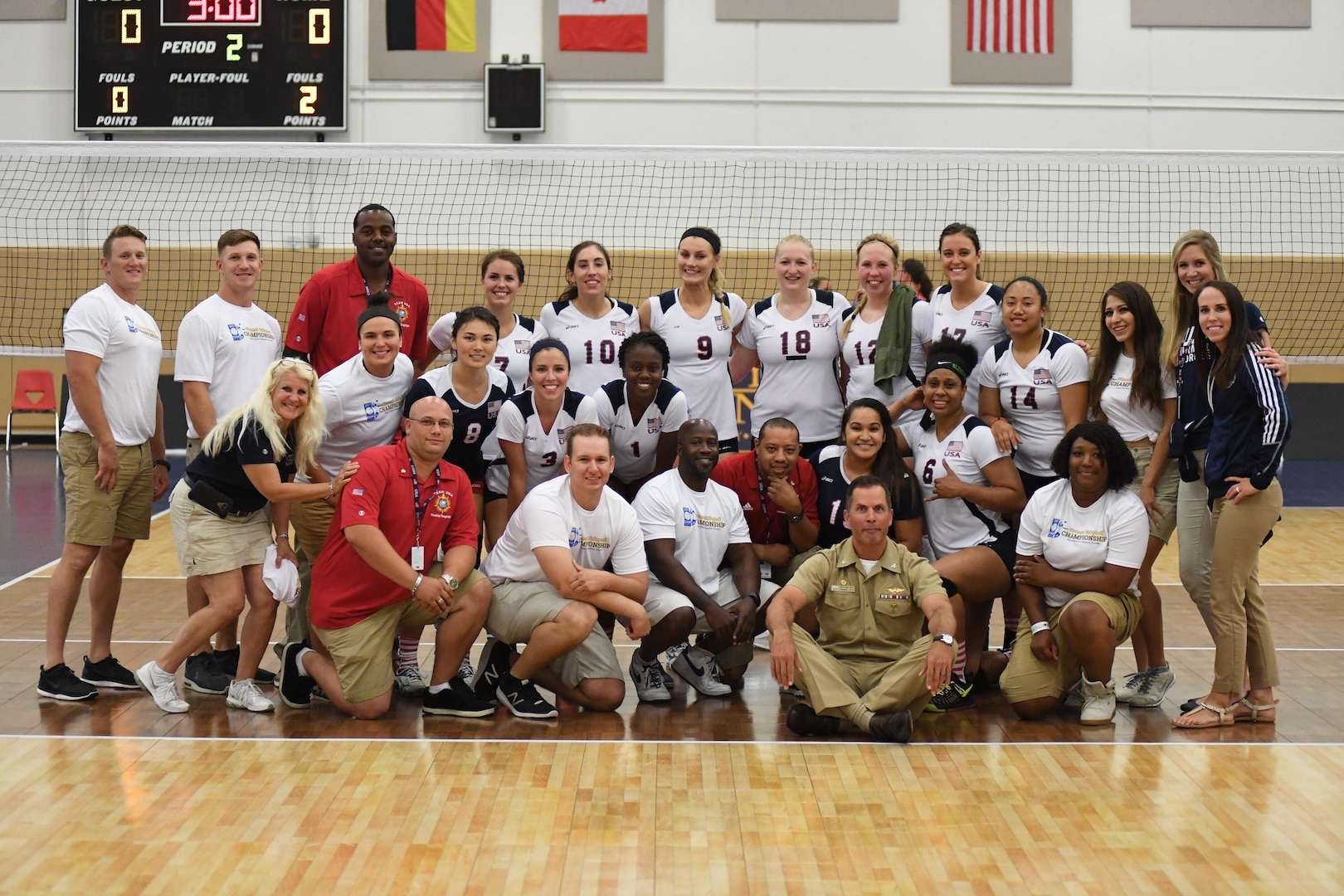 Naval Station Mayport Base Commander Navy Captain David Yoder joins the U.S. squad after USA defeated Germany in Match 6 of the 18th Conseil International du Sport Militaire (CISM) World Women's Military Volleyball Championship on 6 June 2017 at Naval Station Mayport, Florida. (Photo by Petty Officer 2nd Class Timothy Schumaker, NPASE East).
