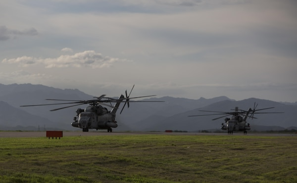 Marines with the Aviation Combat Element, Special Purpose Marine Air-Ground Task Force –Southern Command, taxi down the runway in CH-53E Super Stallion helicopters June 1, 2017, at Soto Cano Air Base, Honduras. The main body of SPMAGTF-SC arrived in Honduras to begin their six-month deployment in Central America. The task force, comprised of approximately 300 Marines from both active and reserve components, will operate in Belize, El Salvador, Guatemala and Honduras from June to November to conduct engineering projects and build upon security cooperation efforts and established relationships in the region. (U.S. Marine Corps photo by Sgt. Ian Leones)